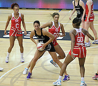 20.1.2014 New Zealand's Jodi Brown competes for ball with England's Geva Mentor during their netball test match in London, England. Mandatory Photo Credit (Pic: David Klein). ©Michael Bradley Photography.