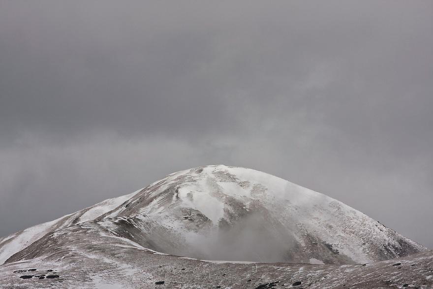 Cloudy sky and fresh snow on Mount Vel'kà kopa (2052 m asl) in the Western Tatras, Slovakia. June 2009. Mission: Ticha