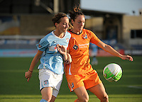 Chicago Red Star forward Kosovare Asllani (10) battles for the ball with Sky Blue FC defender Danielle Johnson (15).  The  Chicago Red Stars defeated the Sky Blue FC 2-0 at Toyota Park in Bridgeview, IL on July 10, 2010.