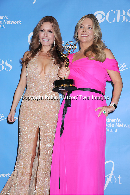 Tracey E Bregman and Maria Bell posing in the press room at the 38th Annual Daytime Emmy Awards  on June 19, 2011 at The Las Vegas Hilton in Las Vegas Nevada. ..