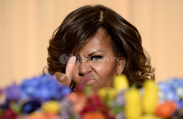 First Lady Michelle Obama gives a thumbs up at the annual White House Correspondents Association Gala at the Washington Hilton Hotel, May 3, 2014 in Washington, DC. <br /> Credit: Olivier Douliery / Pool via CNP /MediaPunch