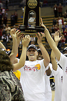 BERKELEY, CA - MARCH 30: Jayne Appel hoists the regional champions trophy following Stanford's 74-53 win against the Iowa State Cyclones on March 30, 2009 at Haas Pavilion in Berkeley, California.