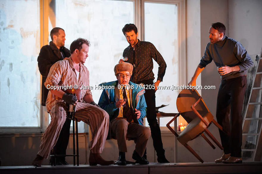 London, UK. 14.10.2015. English National Opera presents, in a co-production with Dutch National Opera, Amsterdam, Puccini's LA BOHEME, at the London Coliseum. Picture shows: Ashley Riches (Schaunard), Duncan Rock (Marcello), Simon Buteriss (Benoit), Zach Borichevsky (Rodolfo), Nicholas Masters (Colline).  Photograph © Jane Hobson.