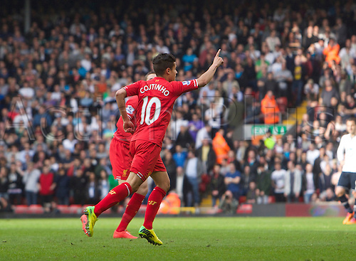 30.03.2014  Liverpool, England. Liverpool's Pillippe Coutinho celebrates after he scores to make it 3-0  during the Premier League game between Liverpool and Tottenham Hotspur from Anfield
