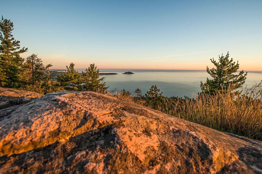 Dawn breaks over Lake Superior at Sugarloaf Mountain near Marquette, Michigan.