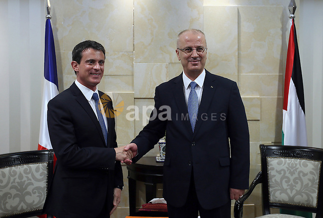 Palestinian Prime Minister, Rami Hamdallah, meets with French Prime Minister Manuel Valls, in the West Bank city of Ramallah, on May 24, 2016. Photo by Prime Minister Office