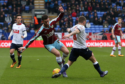 27.02.2016. Macron Stadium, Bolton, England. Skybet Championship. Bolton versus Burnley. David Jones of Burnley is tackled by Jay Spearing of Bolton Wanderers