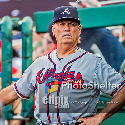 8 July 2017: In his first full season as Manager of the Atlanta Braves, Brian Snitker stands watch in the dugout during a game against the Washington Nationals at Nationals Park in Washington, DC. The Braves shut out the Nationals 13-0 to take the third game of their 4-game series. Mandatory Credit: Ed Wolfstein Photo *** RAW (NEF) Image File Available ***