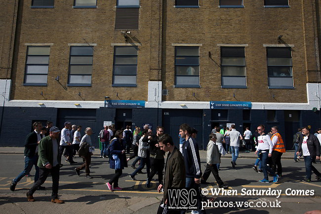 Tottenham Hotspur 4 Watford 0, 08/04/2017. White Hart Lane, Premier League. Supporters walking past the East Stand on Worcester Avenue before Tottenham Hotspur took on Watford in an English Premier League match at White Hart Lane. Spurs were due to make an announcement in April 2016 regarding when they would move out of their historic home and relocate to Wembley as their new stadium was completed. Spurs won this match 4-0 watched by a crowd of 31,706, a reduced attendance figure due to the ongoing ground redevelopment. Photo by Colin McPherson.