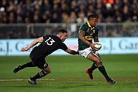 Elton Jantjies beats Ryan Crotty during the Rugby Championship match between the New Zealand All Blacks and South Africa Springboks at QBE Stadium in Albany, Auckland, New Zealand on Saturday, 16 September 2017. Photo: Shane Wenzlick / lintottphoto.co.nz