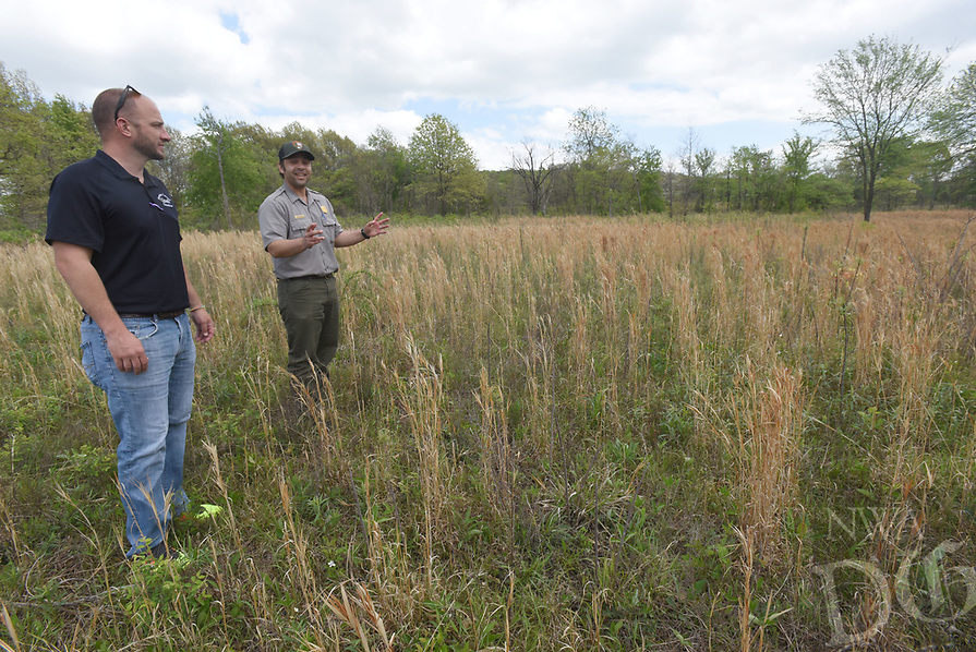 NWA Democrat-Gazette/FLIP PUTTHOFF <br />PARTNERS IN QUAIL<br />Pea Ridge National Military Park and Benton County Quail formed an official partnership on April 19 2017 that will allow the quail conservation group to provide more assistance to the park, particularly its quail restoration project. Benton County Quail donated $4,500 to the project after the agreement was signed. Tanner Bedwell with Benton County Quail (left) and Nolan Moore with Pea Ridge National Military Park tour a section of the park that has been improved for wildlife habitat, particularly quail.  Acres of cedar trees and fescue grass have been removed to restore the Civil War park to its appearance in 1862 when the Battle of Pea Ridge was fought and also to improve habitat for quail and all wildlife.