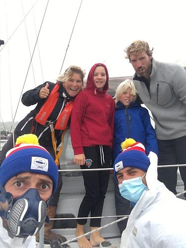 Welcome to Horta! The Azorean Pandemic Patrol managed to put a bit of fun into Danu's arrival for (left to right) Vera, Lillian, Ruari and Peter, but the Kinvara crew still had to spend a night in anchored isolation