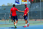 SURPRISE, AZ - MAY 12: Arnold Kokulewski celebrates a game win with partner Jorge Vargas against Carlos Gomez and Vivien Versier of the Barry Buccaneers returns a ball against during the Division II Men's Tennis Championship held at the Surprise Tennis & Racquet Club on May 12, 2018 in Surprise, Arizona. (Photo by Jack Dempsey/NCAA Photos via Getty Images)