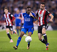 Danny Lafferty of Sheffield United battles with Ahmed Musa of Leicester City during the Carabao Cup match between Sheffield United and Leicester City at Bramall Lane, Sheffield, England on 22 August 2017. Photo by James Williamson / PRiME Media Images.