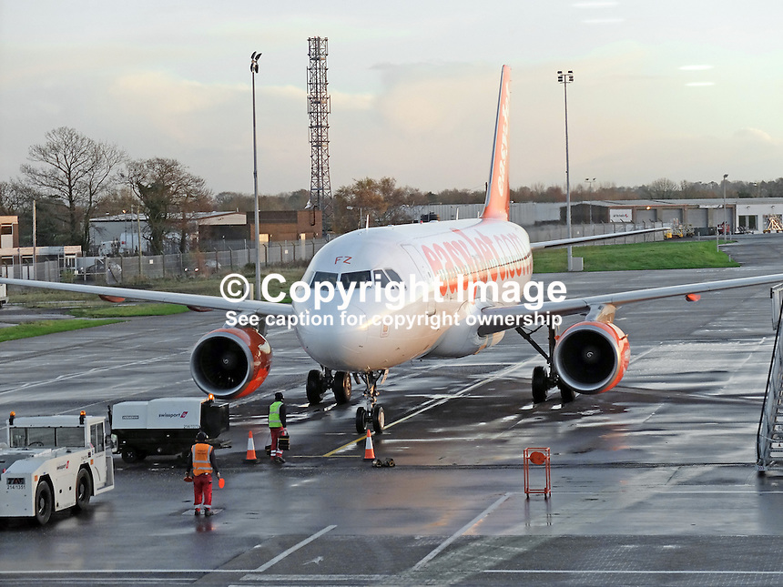 Easyjet Airbus A320 on the tarmac at Belfast International Airport 5th December 2014. 201412050115<br />