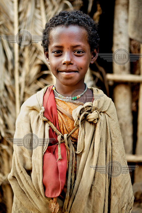 A child from one of the poorest communities in Ethiopia, the Negede Wiotto, playing near his home in a informal settlement.