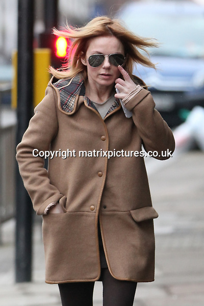 "NON EXCLUSIVE PICTURE: MATRIXPICTURES.CO.UK.PLEASE CREDIT ALL USES..WORLD RIGHTS..British former ""Spice Girls"" pop singer Geri Halliwell is pictured walking through North London...FEBRUARY 25th 2013..REF: WTX 131292"