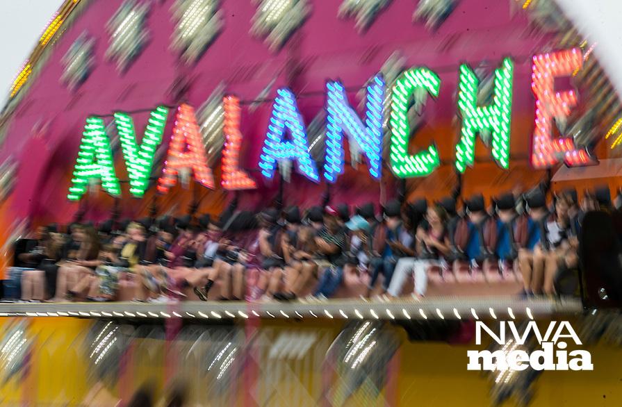 NWA Democrat-Gazette/BEN GOFF @NWABENGOFF<br /> Fairgoers ride the 'Avalanche' Thursday, Aug. 8, 2019, during the Benton County Fair in Bentonville.