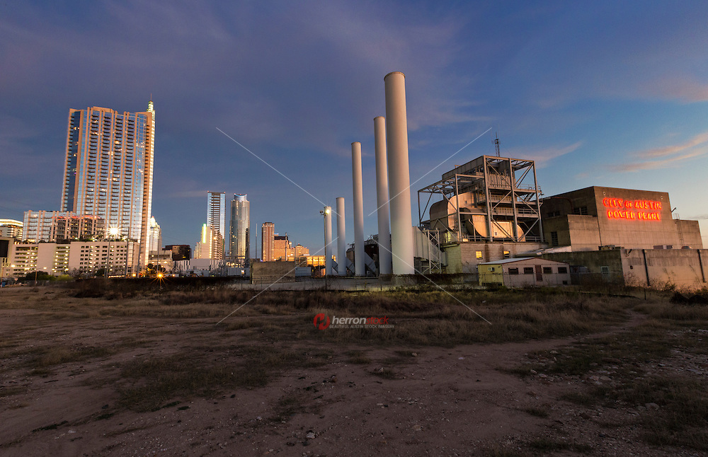 The City of Austin, Seaholm Power Plant's five smoke stacks stand as beacon along the downtown Austin Skyline.