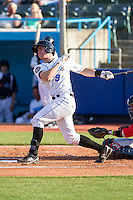 Mac James (9) of the Hudson Valley Renegades follows through on his swing against the Brooklyn Cyclones at Dutchess Stadium on June 18, 2014 in Wappingers Falls, New York.  The Cyclones defeated the Renegades 4-3 in 10 innings.  (Brian Westerholt/Four Seam Images)