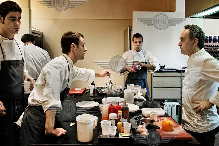 Chef Ferran Adria (right) of El Bulli restaurant, in his workshop working with his team on new recipes.
