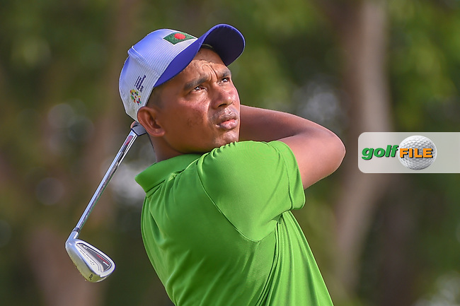 Md Shahab UDDIN (BAN) watches his tee shot on 4 during Rd 1 of the Asia-Pacific Amateur Championship, Sentosa Golf Club, Singapore. 10/4/2018.<br /> Picture: Golffile   Ken Murray<br /> <br /> <br /> All photo usage must carry mandatory copyright credit (© Golffile   Ken Murray)