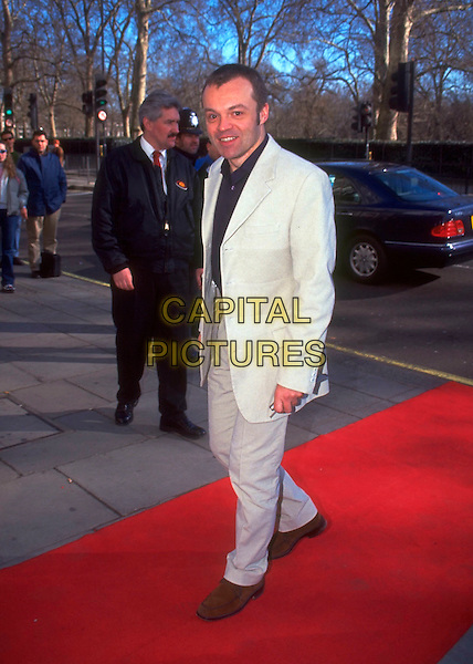 GRAHAM NORTON.The Empire Film Awards, .London, England,.17th January 2000..full length white trouser suit red carpet.CAP/HT.©Hugh Thompson/Capital Pictures