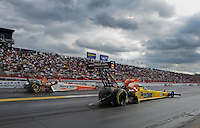 Feb. 12, 2012; Pomona, CA, USA; NHRA top fuel dragster driver Spencer Massey (near lane) races alongside Clay Millican during the Winternationals at Auto Club Raceway at Pomona. Mandatory Credit: Mark J. Rebilas-