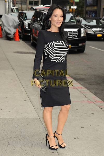 Lucy Liu visits the Late Show with David Letterman, New York City, NY., USA.<br /> October 9th, 2013<br /> full length black white dress stripe  <br /> CAP/MPI/mpi63<br /> &copy;mpi63/MediaPunch/Capital Pictures