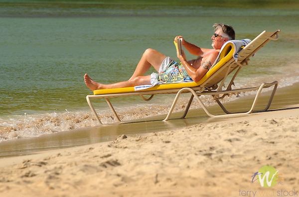 Westin Resort, St. John, USVI, Caribbean. Man reading on beach chair.