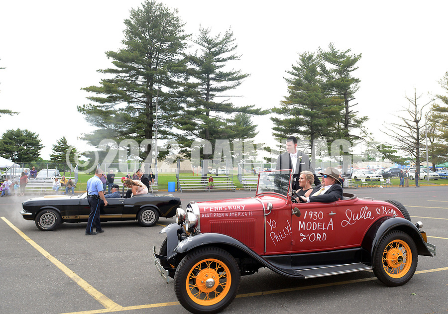 "Kevin Kenny and Julia Jakowiak arrive in an old car during the senior prom parade Saturday, May 20, 2017 at Pennsbury High School East in Fairless Hills, Pennsylvania. Pennsbury's senior prom is one of few still held at the school itself and this year featured the theme ""Yo Philly"" highlighting various features of Philadelphia. (Photo by William Thomas Cain)"