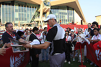 Martin Kaymer (GER) signs autographs after his match during Thursday's Round 1 of the HSBC Golf Championship at the Abu Dhabi Golf Club, United Arab Emirates, 26th January 2012 (Photo Eoin Clarke/www.golffile.ie)