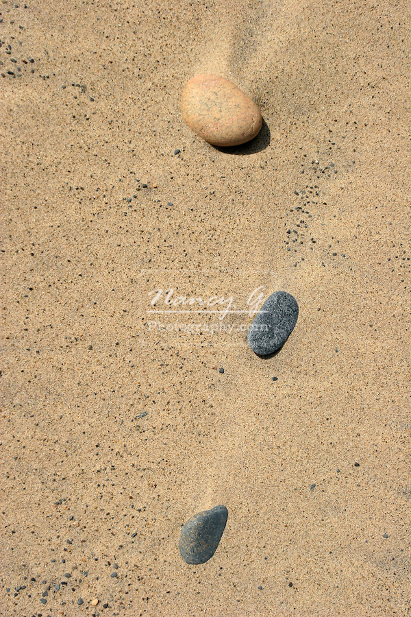 Three washed up granite stones on the shoreline of Lake Superior in Upper Michigan
