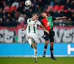 Nederland, Nijmegen, 27 januari 2013.Eredivisie.Seizoen 2012-2013.N.E.C.-FC Groningen .Victor Palsson van N.E.C. en Maikel Kieftenbeld van FC Groningen strijden in een kopduel.