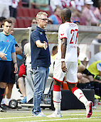 01.08.2015. RheinEnergieStadion, Cologne, Germany.  Cologne team manager Peter Stoger hand slaps Scorer Anthony Modeste the Colonia Cup 2015 between  FC Cologne and Stoke City FC