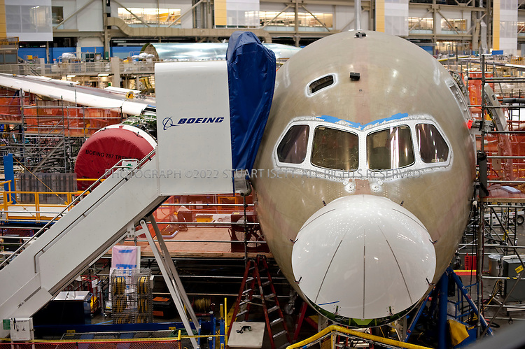 10/22/2009--Everett, WA, USA..At Boeing's Everett, Wash., the first Boeing 787s under production that will be used in the first test flights...The 787-8 Dreamliner will carry 210 - 250 passengers on routes of 7,650 to 8,200 nautical miles (14,200 to 15,200 kilometers), while the 787-9 Dreamliner will carry 250 - 290 passengers on routes of 8,000 to 8,500 nautical miles (14,800 to 15,750 kilometers).  A third 787 family member, the 787-3 Dreamliner, will accommodate 290 - 330 passengers and be optimized for routes of 2,500 to 3,050 nautical miles (4,600 to 5,650 kilometers). ..In addition to bringing big-jet ranges to mid-size airplanes, the 787 will provide airlines with unmatched fuel efficiency, resulting in exceptional environmental performance. The airplane will use 20 percent less fuel for comparable missions than today's similarly sized airplane. It will also travel at speeds similar to today's fastest wide bodies, Mach 0.85. Airlines will enjoy more cargo revenue capacity. Passengers will also see improvements with the new air..©2009 Stuart Isett. All rights reserved.