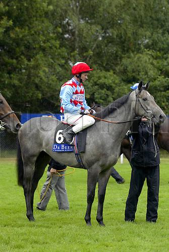 July 26, 2003: Jockey MICHAEL HILLS sitting on RIVER NUREY before the start of the European Breeders Fund Crocker Bulteel Maiden Stakes. De Beers Diamond Day, Ascot Photo: Glyn Kirk/Action Plus...Horse Racing Flat 030726 Horses jockey jockeys