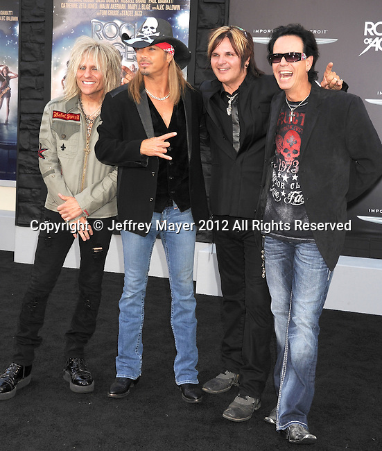 HOLLYWOOD, CA - JUNE 08: Musicians C.C. Deville, Bret Michaels, Rikki Rockett and Bobby Dall of Poison arrive at the 'Rock Of Ages' - Los Angeles Premiere at Grauman's Chinese Theatre on June 8, 2012 in Hollywood, California.