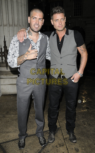 SHANE LYNCH & KEITH DUFFY.The Quintessentially Awards, Freemason's Hall, London, England..June 1st, 2010.full length grey gray black waistcoat tattoos hand white cardigan trousers paisley boyzone.CAP/CAN.©Can Nguyen/Capital Pictures.
