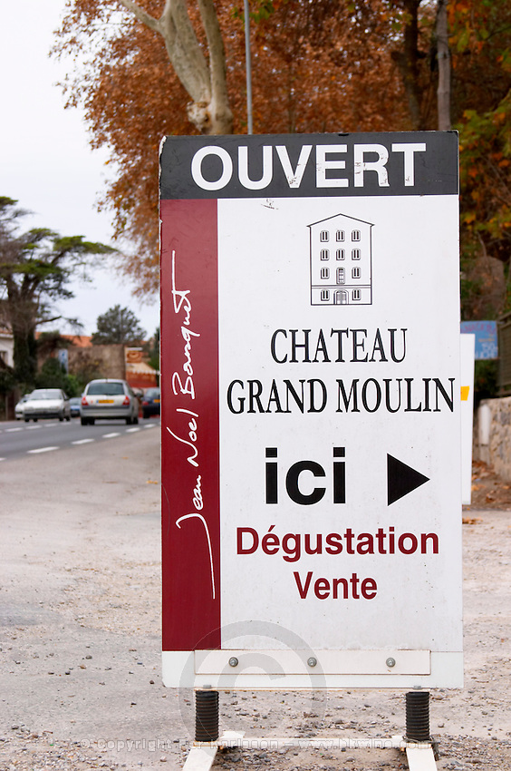 It's open, tasting, sales, advertising sign Chateau Grand Moulin. In Lezignan-Corbieres. Les Corbieres. Languedoc. France. Europe.