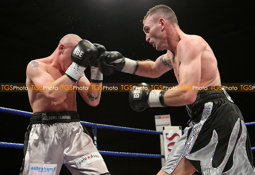 Colin Lynes (Hornchurch, silver/black shorts) defeats Juho Tolppola (Finland, silver shorts) in a Light-welterweight contest for the European Title at Goresbrook Leisure Centre, Dagenham, promoted by Matchroom Sport - 25/01/08 - MANDATORY CREDIT: Gavin Ellis/TGSPHOTO. Self-Billing applies where appropriate. NO UNPAID USE. Tel: 0845 094 6026
