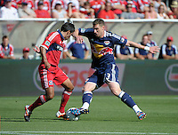 New York forward Kenny Cooper (33) maneuvers around Chicago midfielder Pavel Pardo (17).  The Chicago Fire defeated the New York Red Bulls 3-1 at Toyota Park in Bridgeview, IL on June 17, 2012.