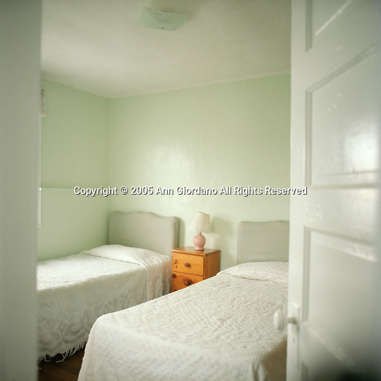 Two twin beds and night table in motel room