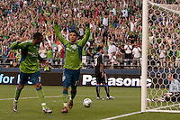 Tyrone Marshall (l) and Fredy Montero (17) celebrate Montero's goal as Arturo Alvarez (10) and Joe Cannon (r) look on in the Seattle Sounders 2-1 win against San Jose Earthquake on Saturday, June 13, 2009 at Quest Field in Seattle, WA.