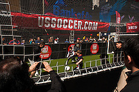 Fans watch kids play a small sided game during the centennial celebration of U. S. Soccer at Times Square in New York, NY, on April 04, 2013.