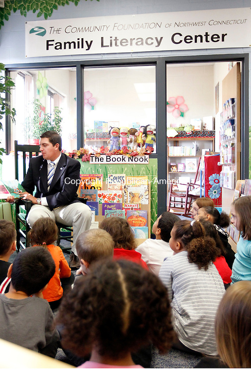 "Torrington, CT-22 October 2012-102212CM01-  Torrington Mayor, Ryan Bingham reads ""The Hallo-Wiener"", a children's book by Dav Pilkey to Laura Henry's first grade class at Forbes School Monday morning in Torrington.  The Community Foundation of Northwest Connecticut Family Literacy Center will hold a grand opening of it's new center at the school Tuesday night from 5pm-8pm.  The center will be open to the Torrington community on Tuesday nights and will feature parenting books, DVD's and games to help children read from the time they're babies.    Christopher Massa Republican-American"