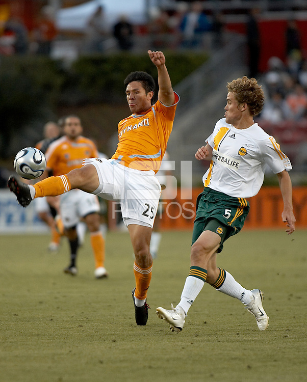 Houston Dynamo forward Brian Ching (25) receives the ball as Los Angeles Galaxy defender defender Chris Albright (5) gives chase.  Houston Dynamo and Los Angeles Galaxy played to a 0-0 tie at Robertson Stadium in Houston, TX on April 8, 2007.