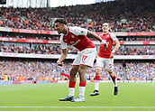 1st October 2017, Emirates Stadium, London, England; EPL Premier League Football, Arsenal versus Brighton; Alex Iwobi of Arsenal celebrates scoring his sides second goal, 2-0 Arsenal