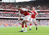 1st October 2017, Emirates Stadium, London, England; EPL Premier League Football, Arsenal versus Brighton; Alex Iwobi of Arsenal celebrates scoring his sides second goal, 2-0 Arsenal