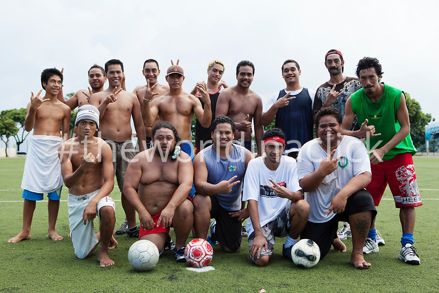 FRENCH POLYNESIA, Tahiti, Papeete. A soccer game between locals at the Willy Bambridge Stadium. Portrait of the soccer players.